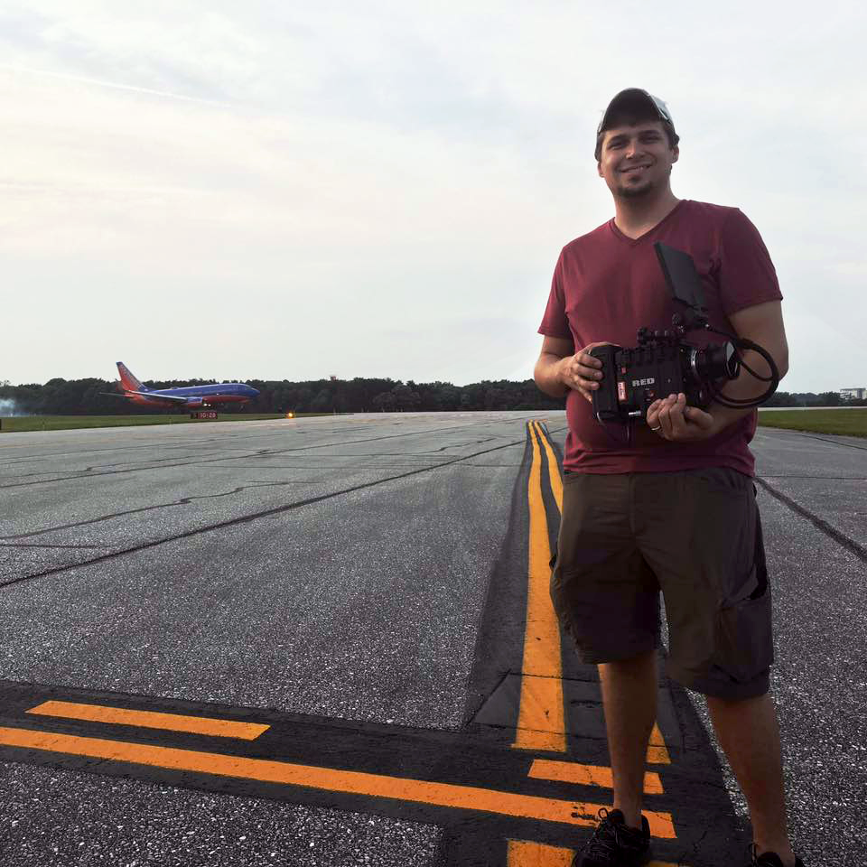 Bonnemaison Inc David Partin holding the RED on the runway at BWI airport