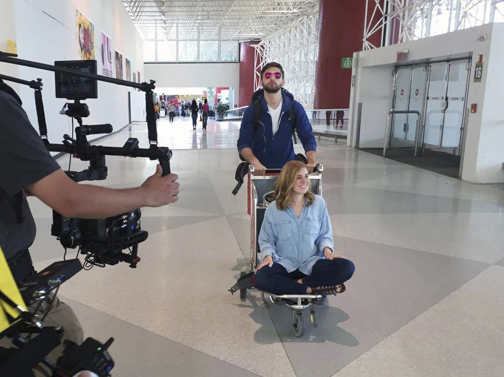 Talent acting in front of camera gear at BWI airport