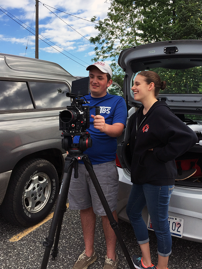 Two of Bonnemaison, Inc. summer interns working with film gear on location