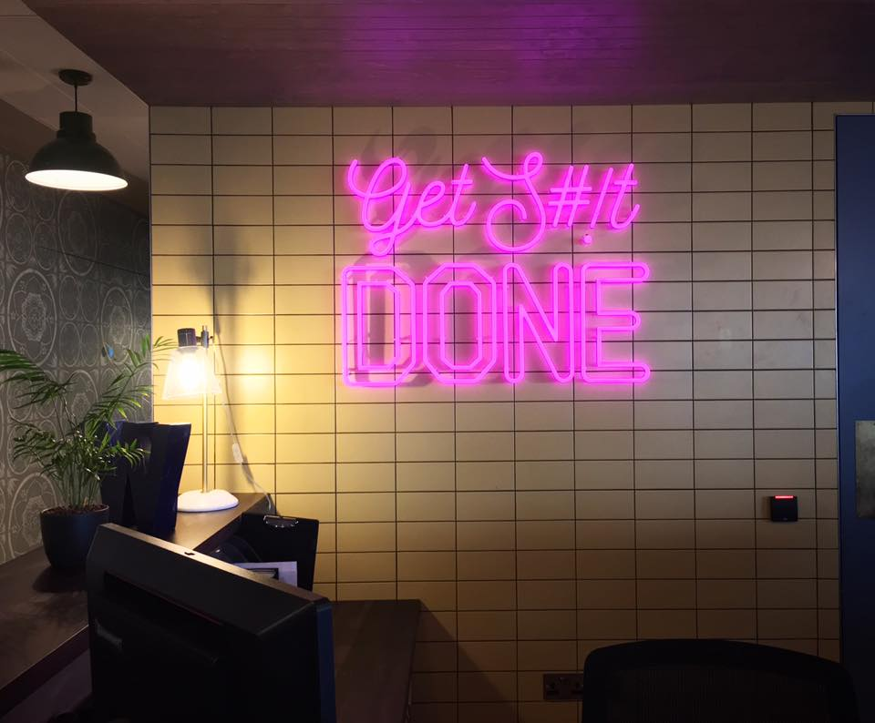 Neon sign at Location today, WeWork Aldgate Tower