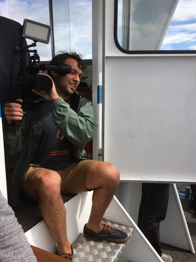 Curtis Mariano on a charter boat in Zurich filming