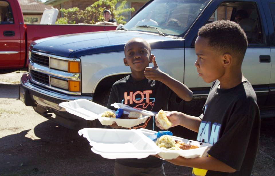 Image of two children being fed in South Carolina by Mercy Chefs & Bonnemaison Inc