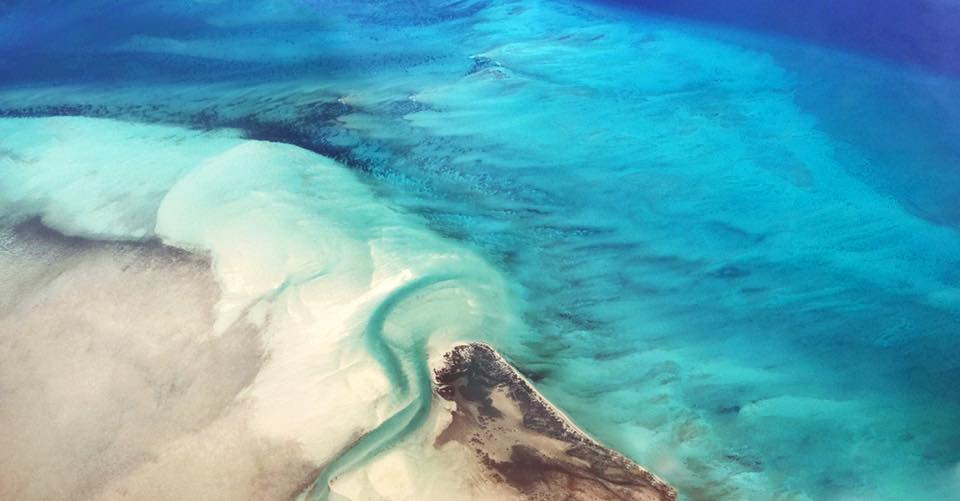 Aerial photograph of the caribbean's sand and ocean