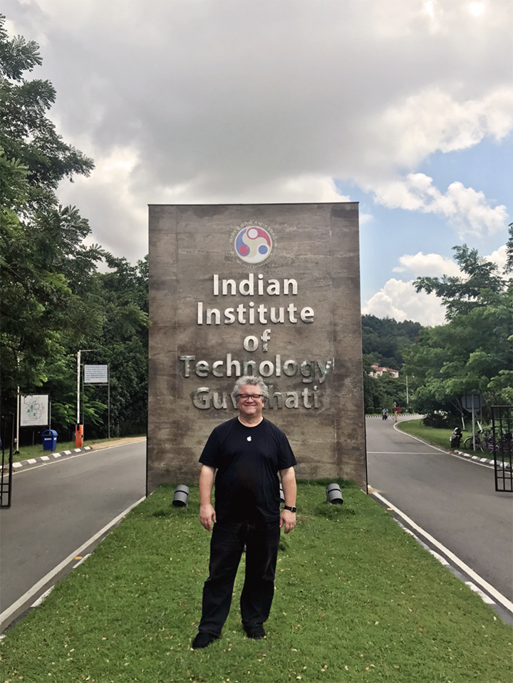 Photo of Brooks Moore in front of The Indian Institute of Technology in India