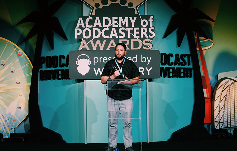 Photo of Dallas Taylor accepting an award on behalf of Podcast, Twenty Thousand Hertz